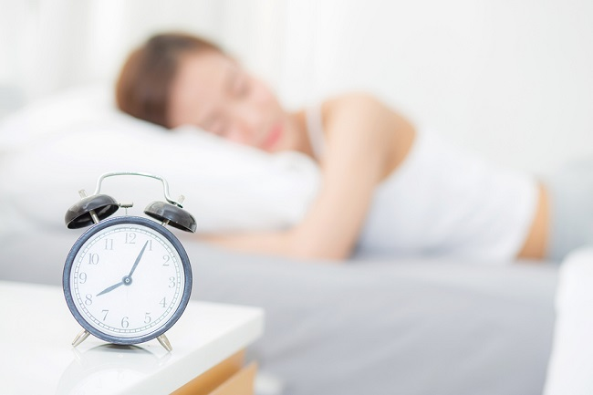 bigstock-Closeup-Alarm-Clock-And-Beauti-231018742