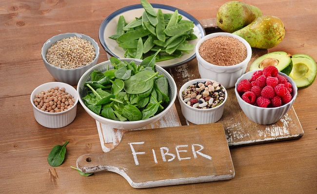 bigstock-Foods-Rich-In-Fiber-On-A-Woode-124799057