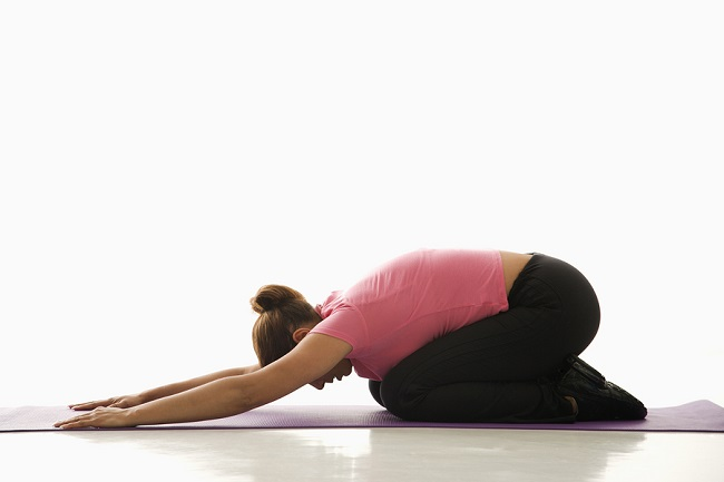 bigstock-Woman-Practicing-Yoga-2682915